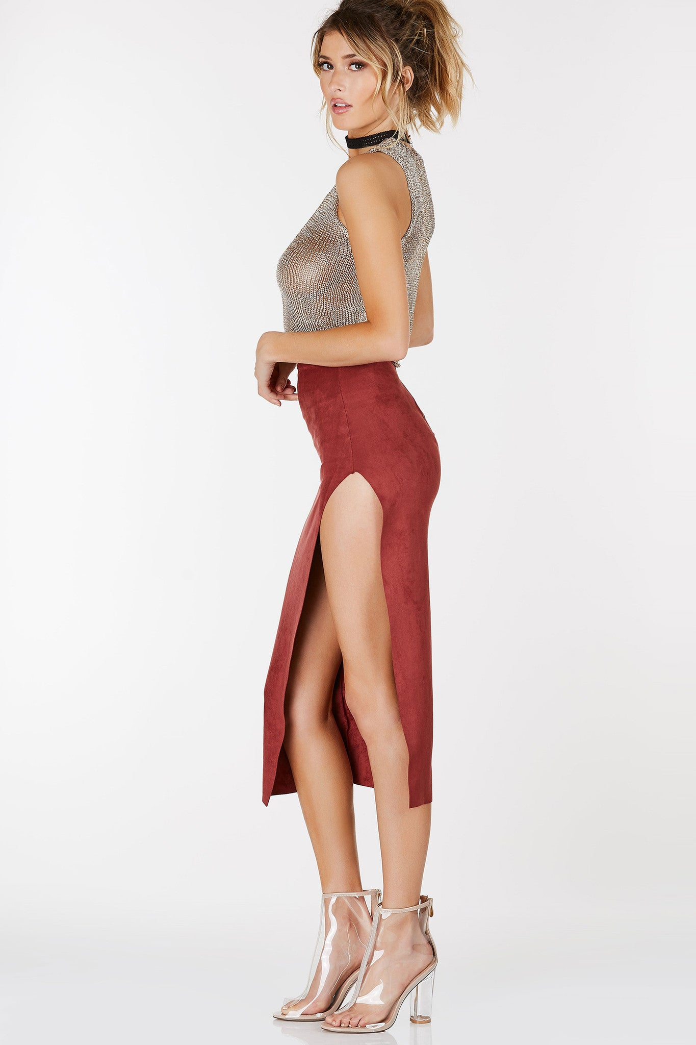 Lightweight midi skirt with suede finish. High slit with back zip closure.