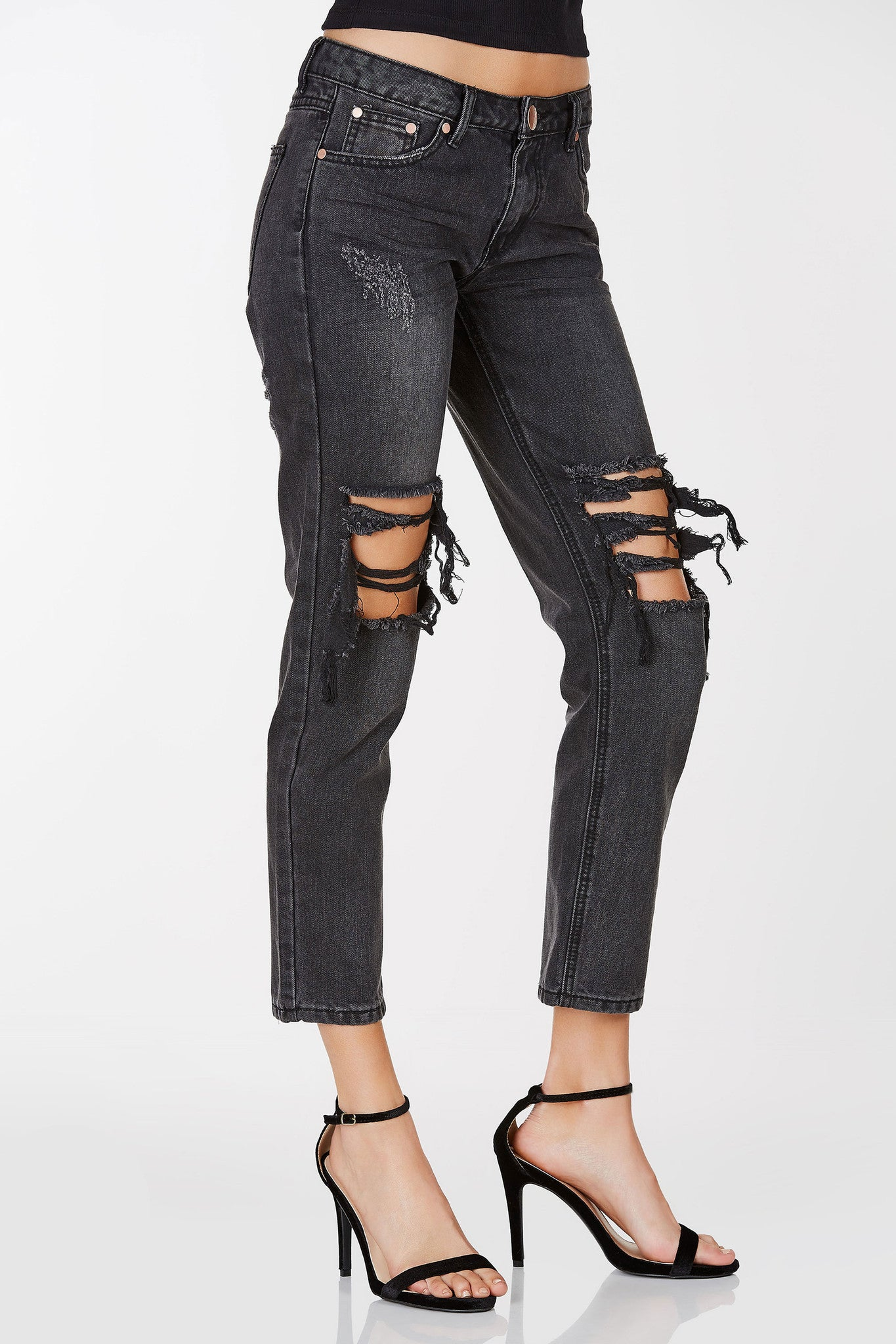 Faded dark wash boyfriend jeans with heavy distressing at knees. Straight hem with zipper and button closure.