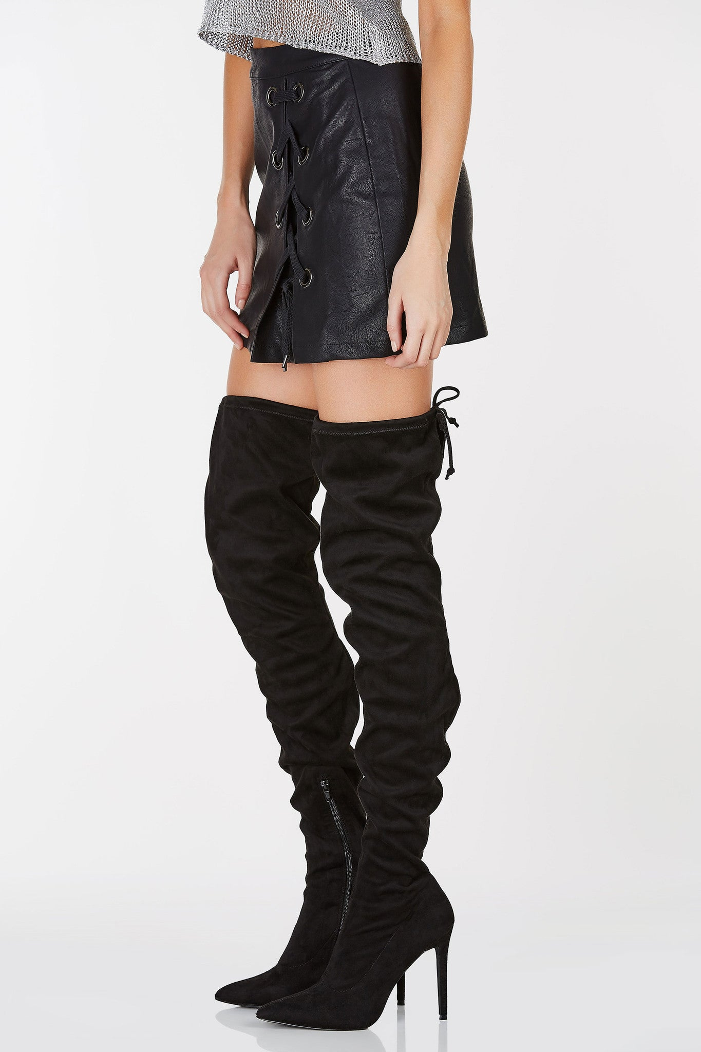 Mid rise mini skirt with faux leather finish. Lace up detailing with back zip closure.
