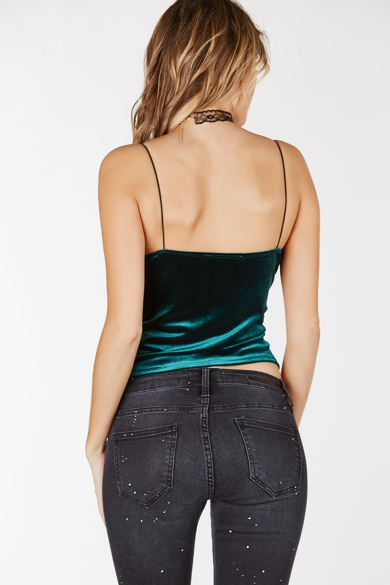 V-neckline with cord shoulder straps. Cropped straight hem with velvet finish.