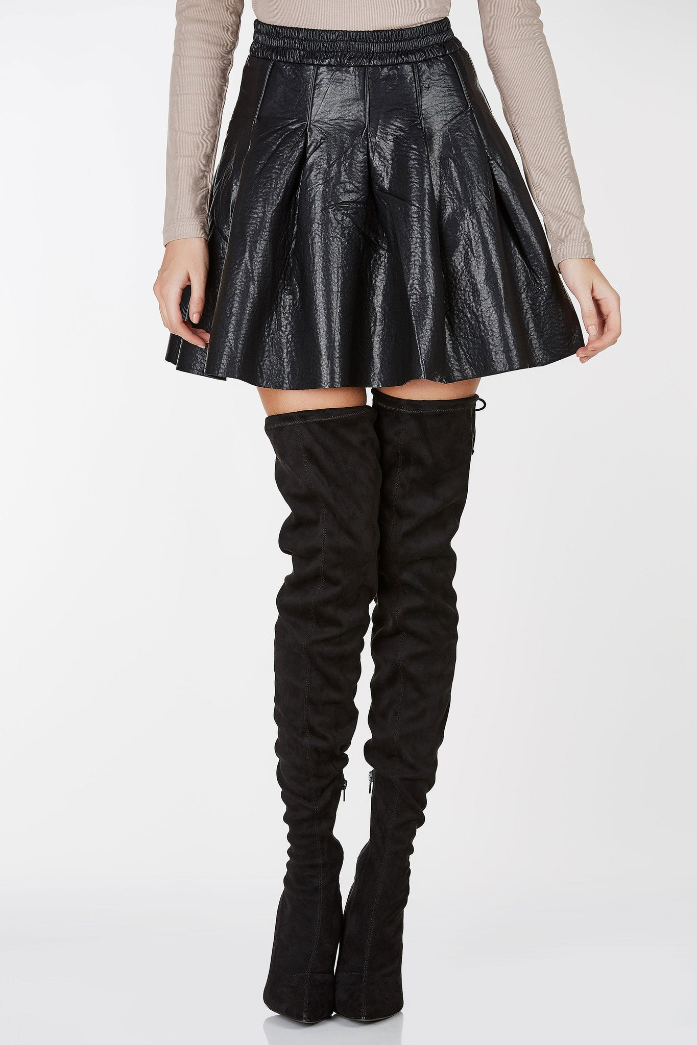 Pleated skater skirt silhouette. Elastic waistband with back zipper closure.