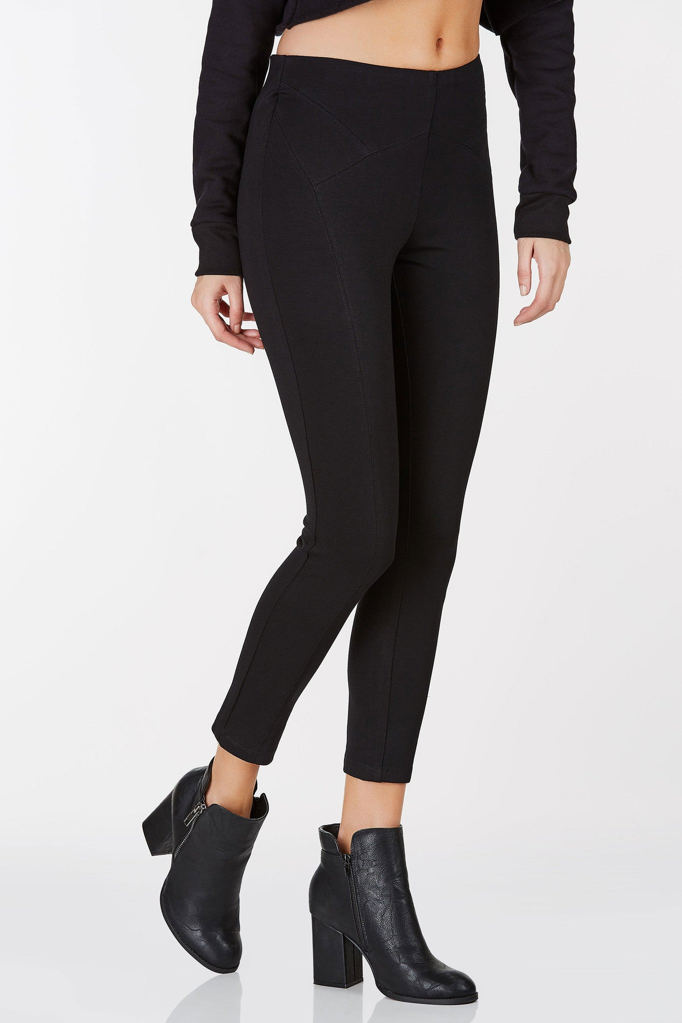 High rise pants with detailed seamwork throughout. Slim fit with back zip closure and cropped hem.