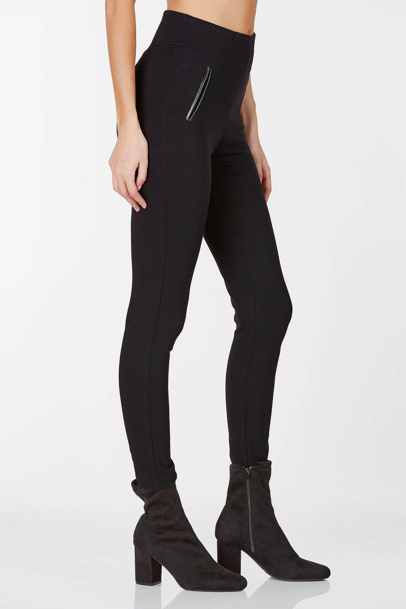 High waisted pants with back zip closure. Contrast faux leather detailing in front with stretchy fit.