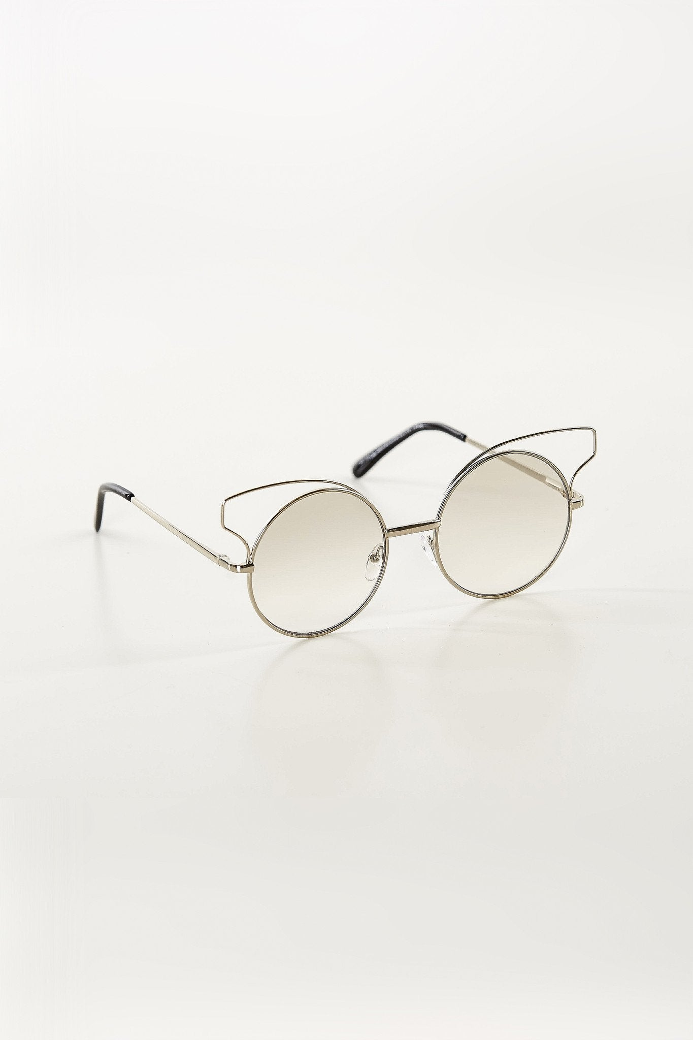 Round lenses with metal frames and cat eye design.