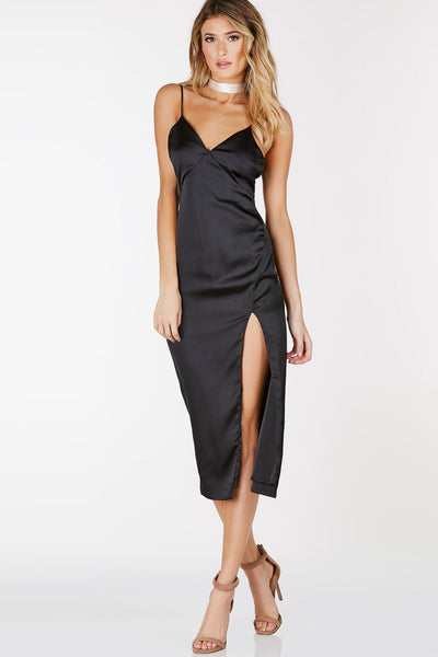 V-neck midi dress with adjustable shoulder straps. Back zip closure and slit in front.