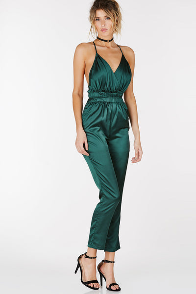 V-neck wrap neckline. Criss-cross back with adjustable straps. Empire gathered waistline. Has lining.
