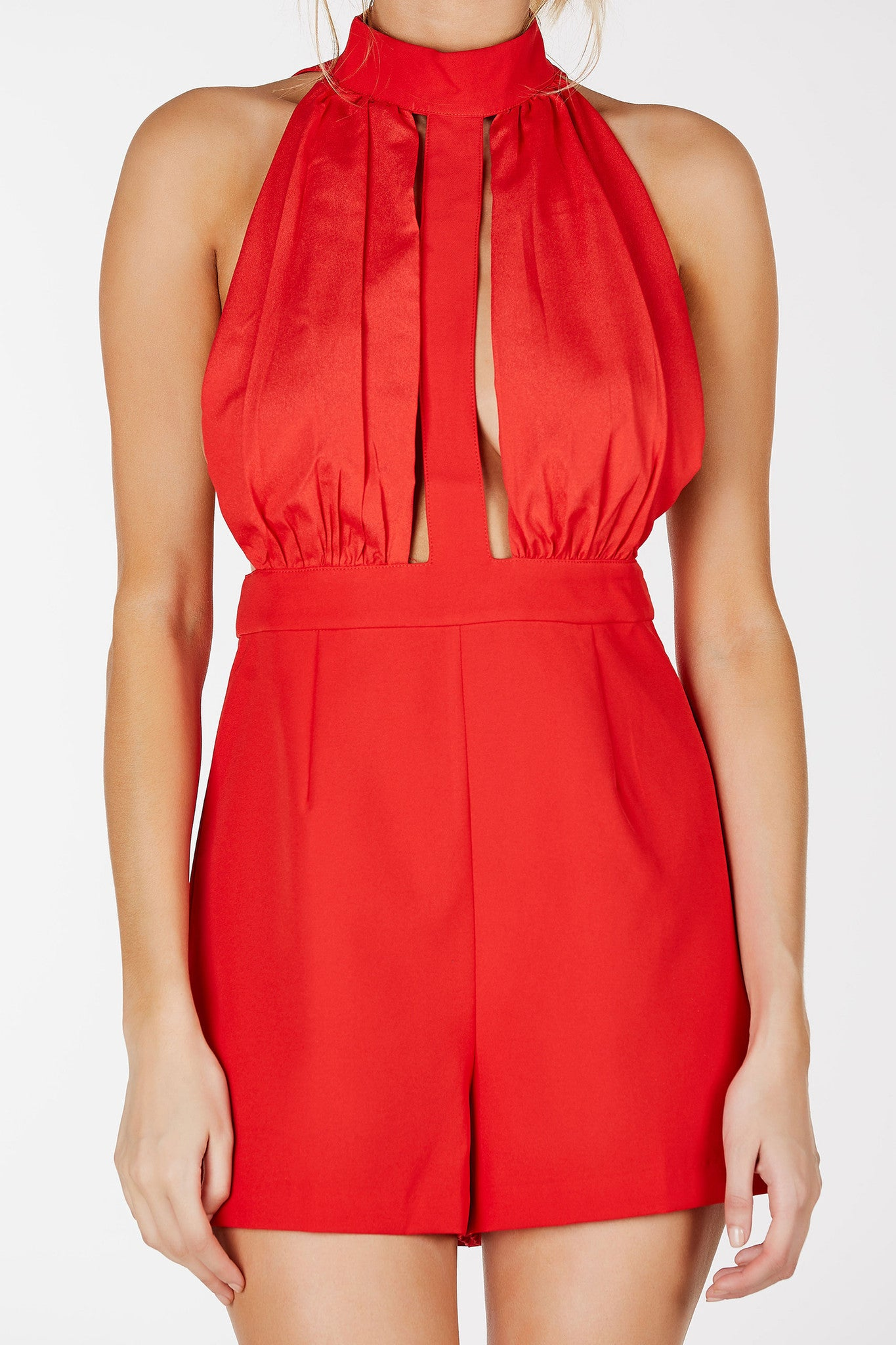 Halter style romper with mock neckline. Pleated body with cut outs in both front and back. Hook and eye clasps and hidden zip closure.
