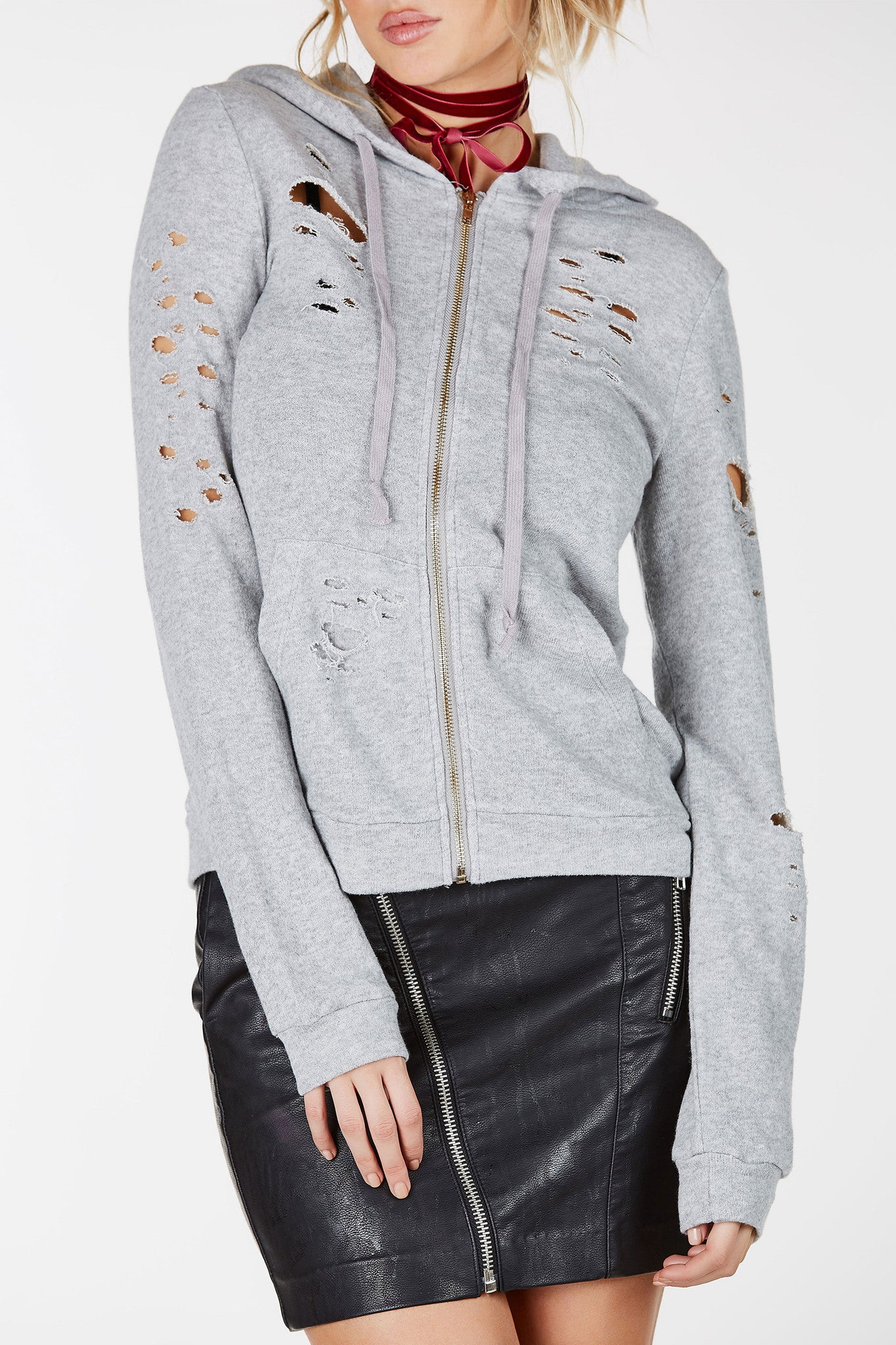 Long sleeve hoodie with drawstring detail. Distressed throughout with two front pockets.