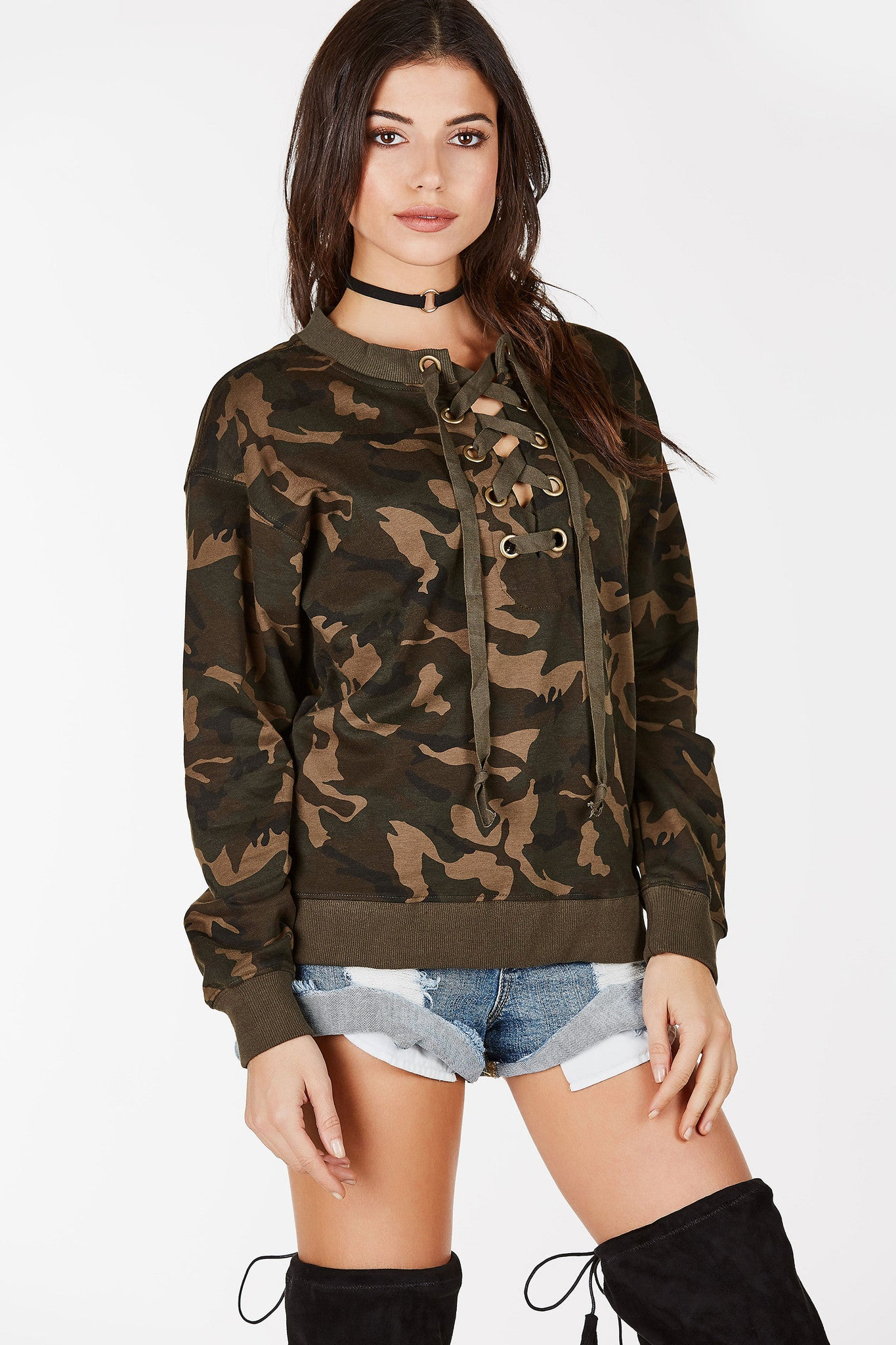 Camo print sweater with lace up front. Pair with jeans or leggings for a comfy, casual look.