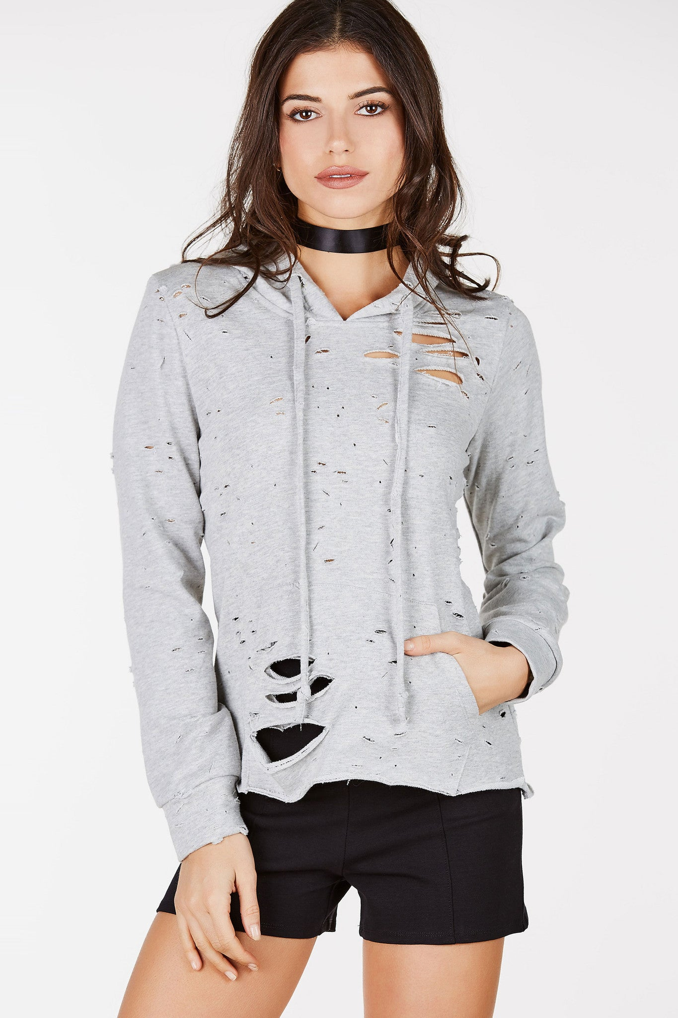 Overly distressed long-sleeved hoodie. Raw bottom hem for a casual look.