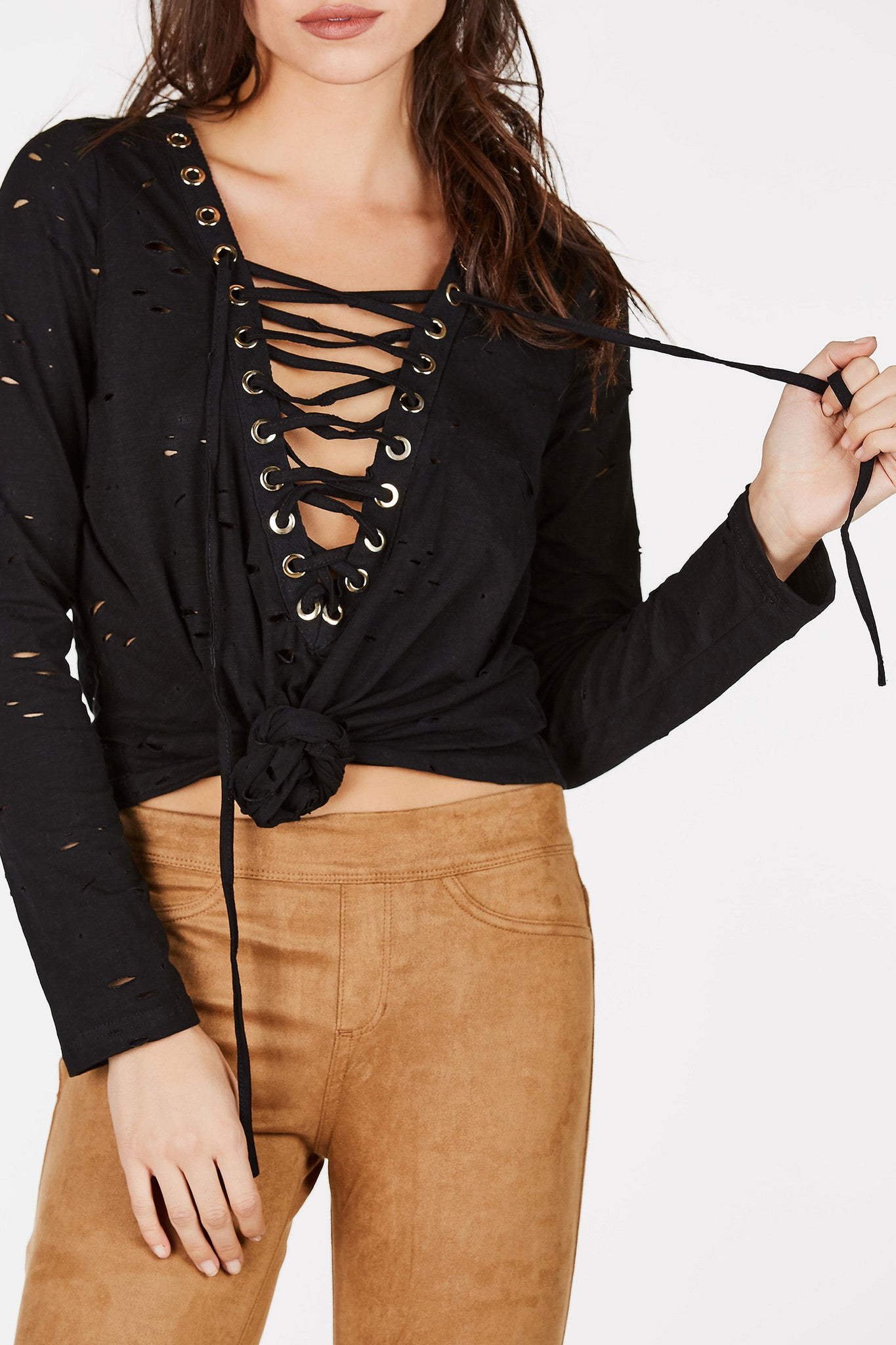 Distressed long sleeve top. Plunging neckline with lace up and kotted front.