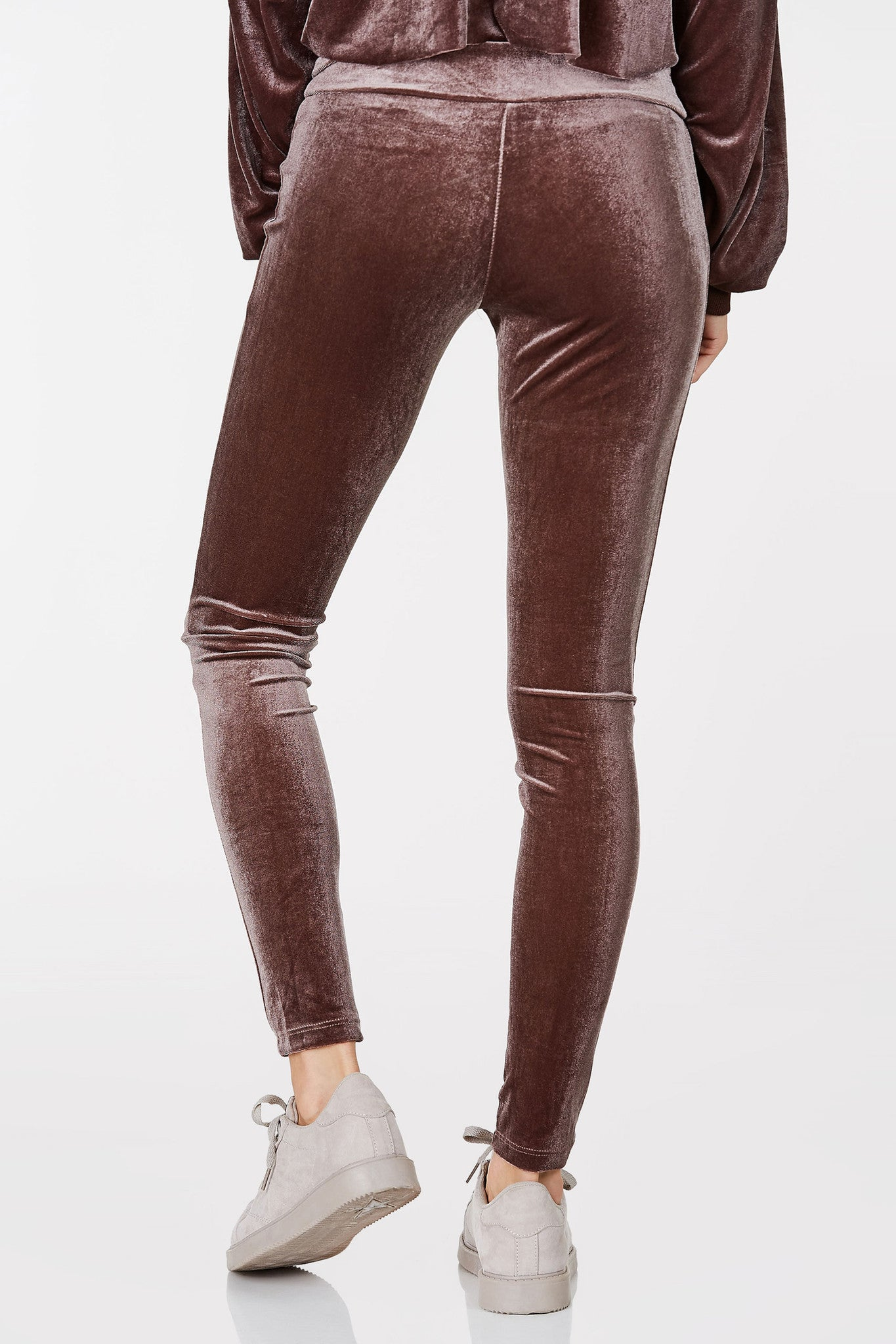 Basic stretchy mid rise leggings with velvet finish. Fold over waistband with straight hem.