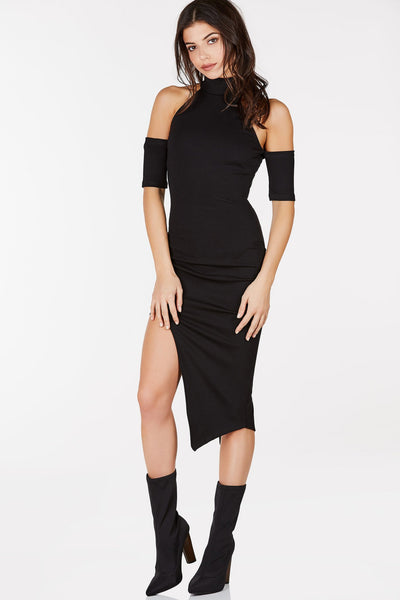 Mock neck midi dress with cold shoulder design. Asymmetrical hem with geometric cut outs.