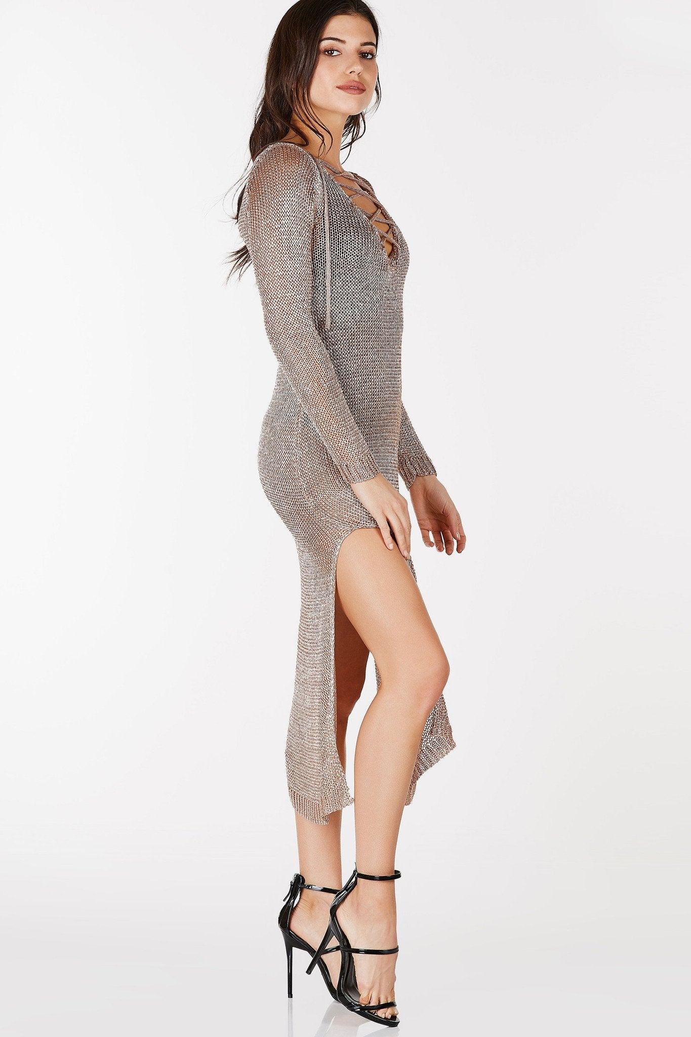 Deep V-neckline with lace up detailing. Long sleeve with high slits on each side. Loose knit throughout with metallic finish.