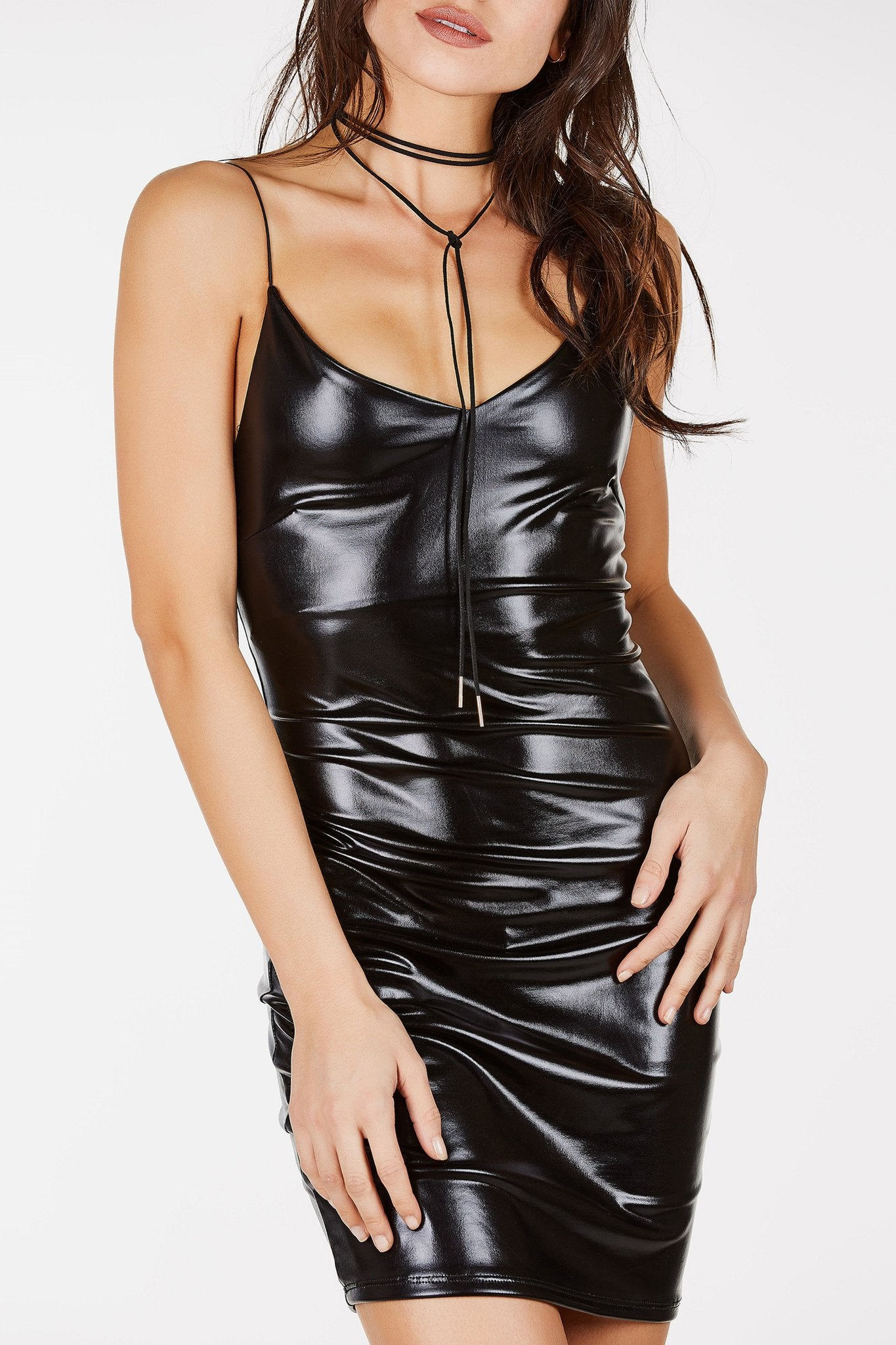 Spaghetti strap mini dress with V-neckline. Pleather finish with straight hem all around.