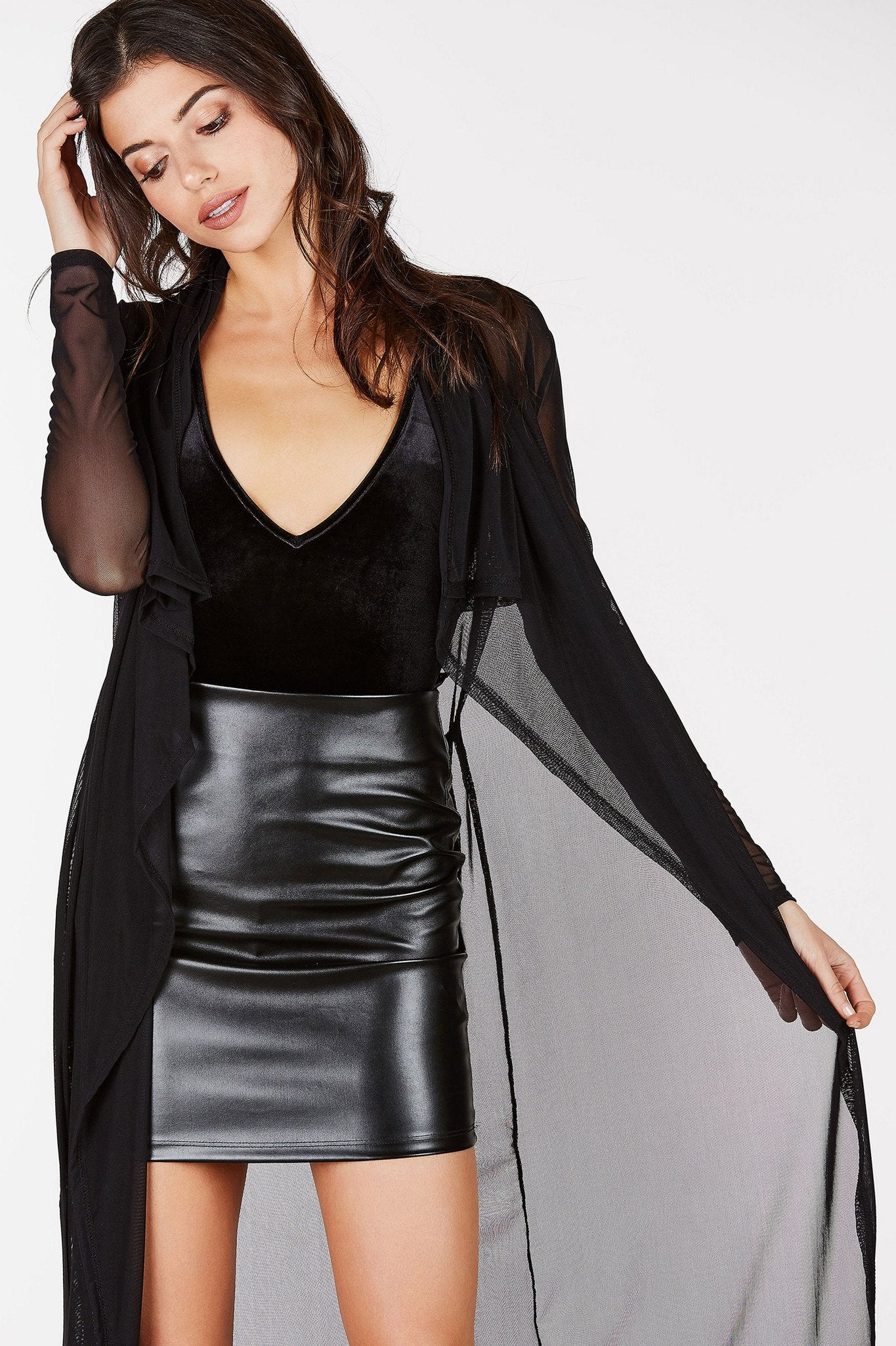 All mesh duster coat with draped open front. Waist tie for fit and closure.