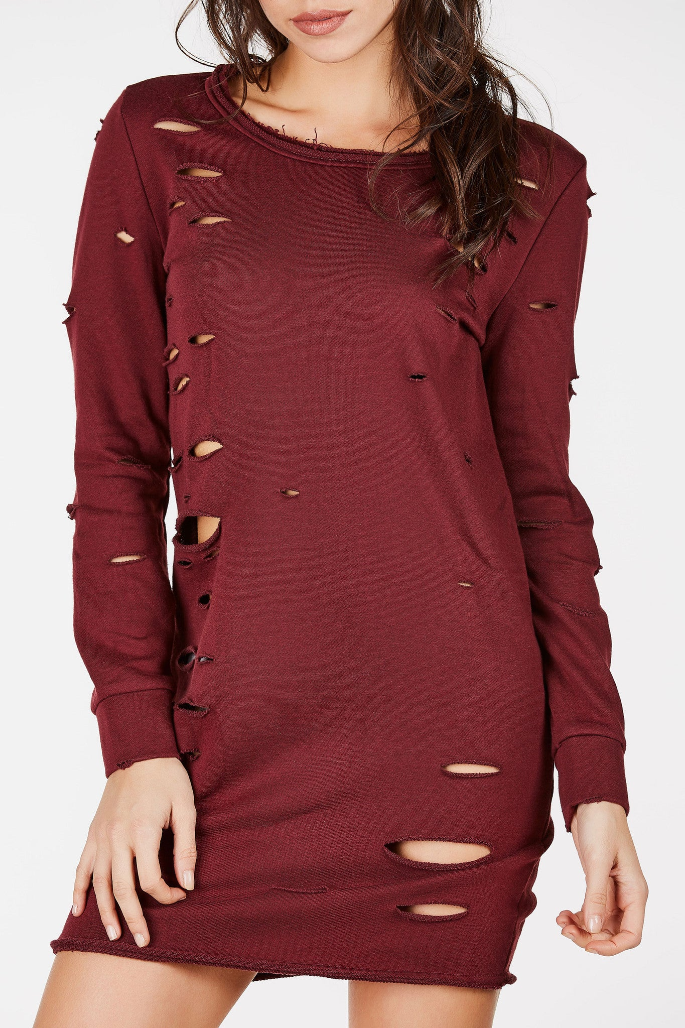 Distressed tunic dress with long sleeves.  With a sweatshirt style and feel, you can dress it up with a pair of thigh high boots or dress it down with sneakers.