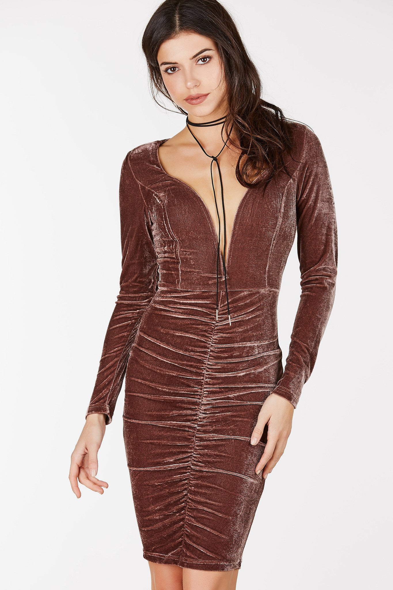 Long sleeve midi dress with deep sweet heart inspired wired neckline. Ruched detailing down the center with velvet finish all around. Slim fit with single back zip closure.