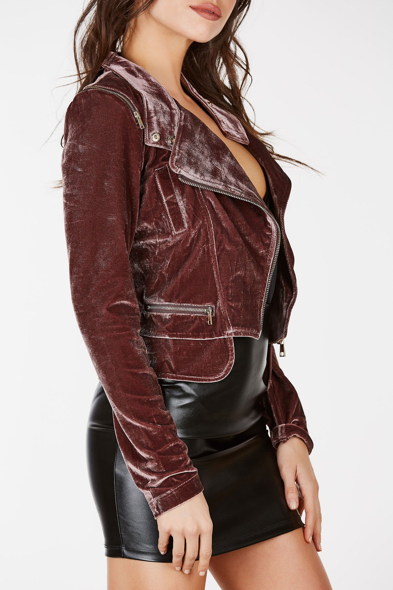 The perfect alternative to a leather moto jacket. Classic moto design with velvet material with gold zipper detailing around shoulders and front.