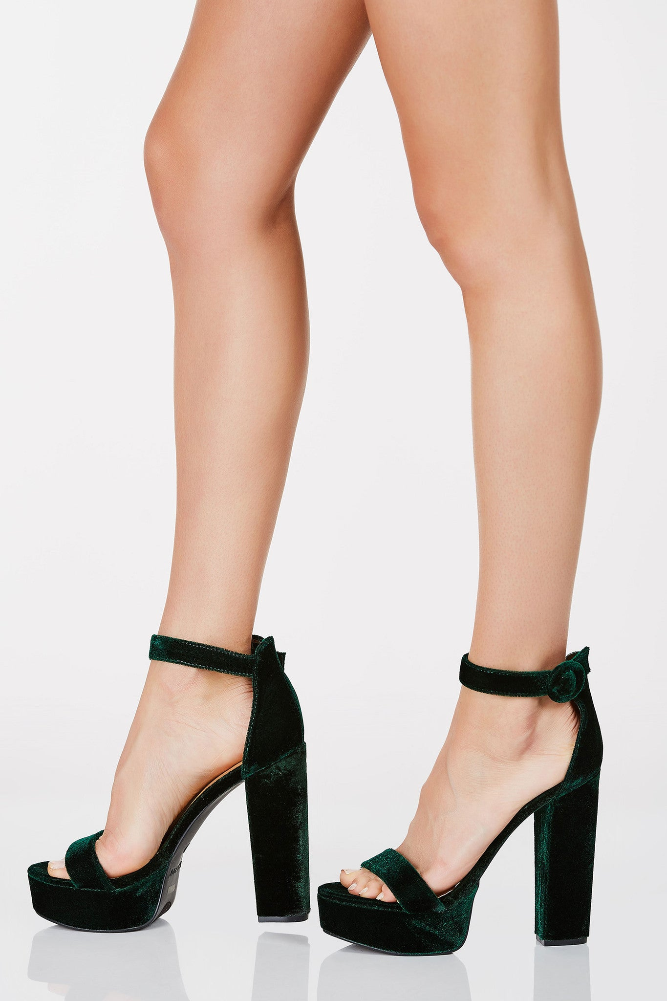 High platforms with ankle strap closure. Open toe with velvet finish all around. Block heels with round buckle for fit.