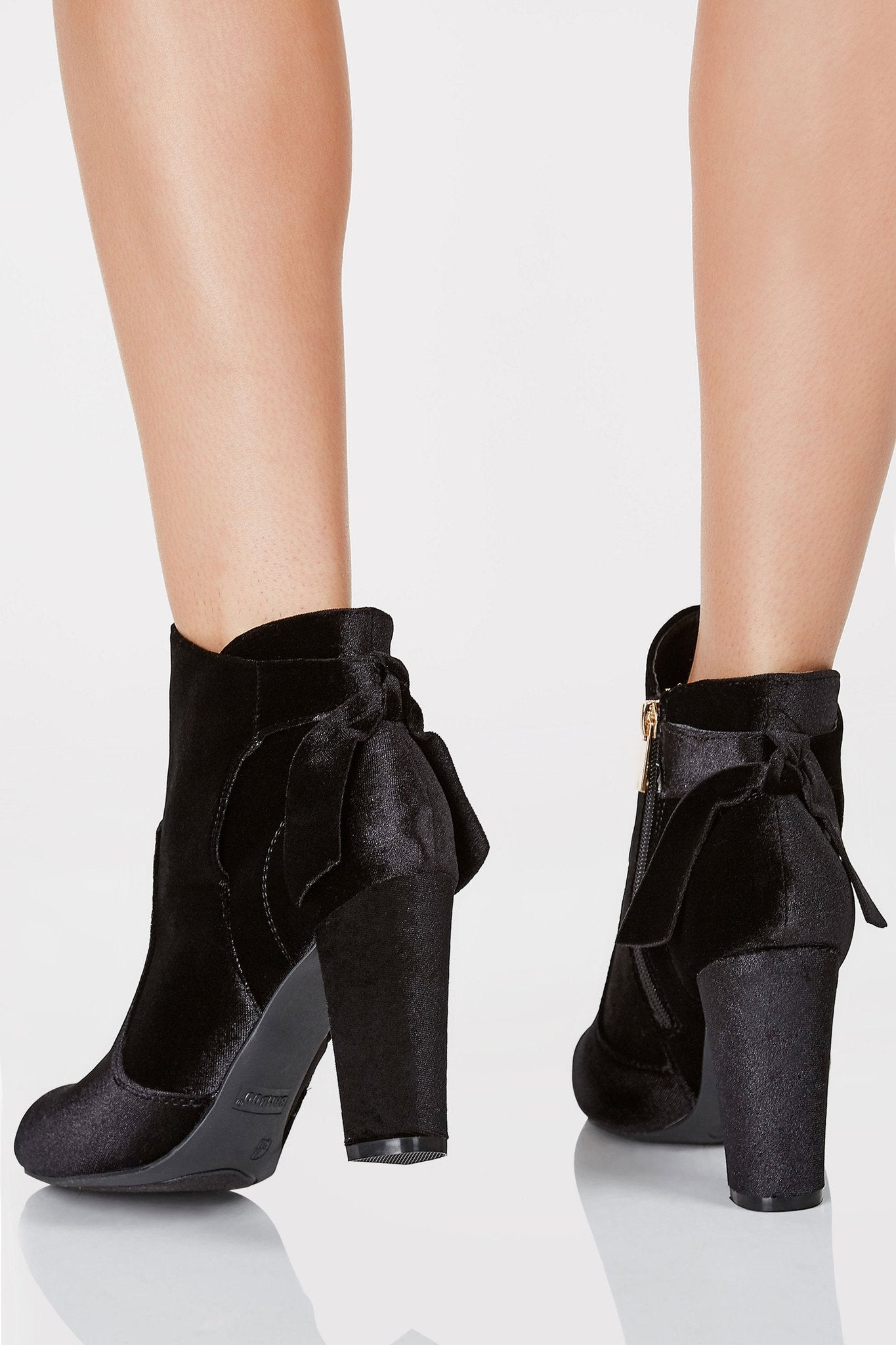Rounded toe ankle boots with velvet finish. Side zip closure with bow detailing at back.
