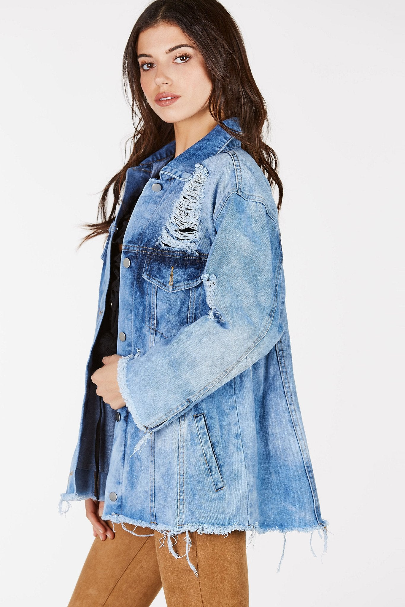 Lightwash, distressed denim jacket.  Frayed hems on bottom and sleeves for a worn look.