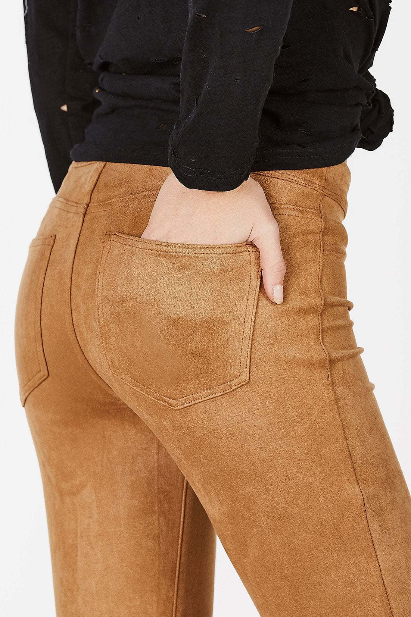 A super soft and stretchy pair of pants that feel like comfy leggings! Trendy suede finish with faux pocket and zip detailing. Slim fit with a versatile mid-rise waist. Great to pair with a bodysuit and heeled booties for a casual chic evening look!