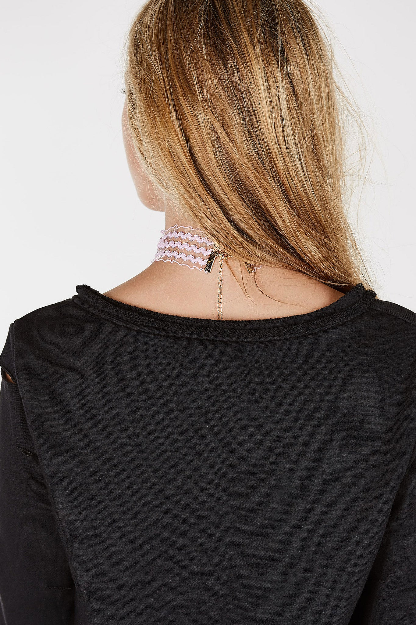 Lace crochet choker with ruffle inspired hem. Lobster clasp for fit and closure.