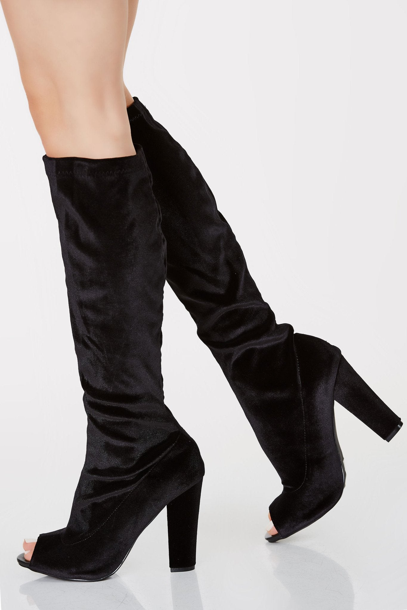 Velvet finish peep toe boots that hits below the knee. Chunky heels with stretchy fit.