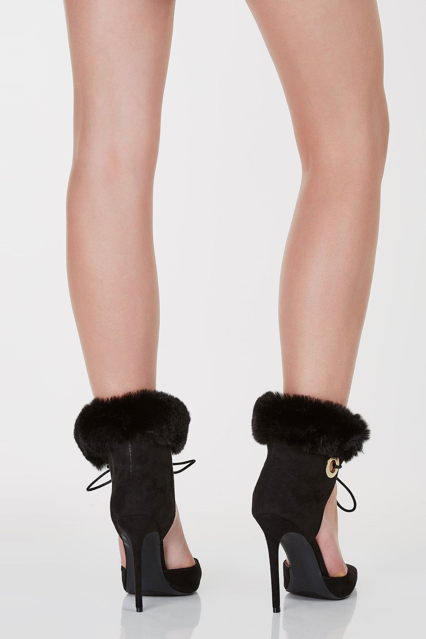 Closed pointed toe pumps with center cut out. Lace up closure with faux fur design at ankles.