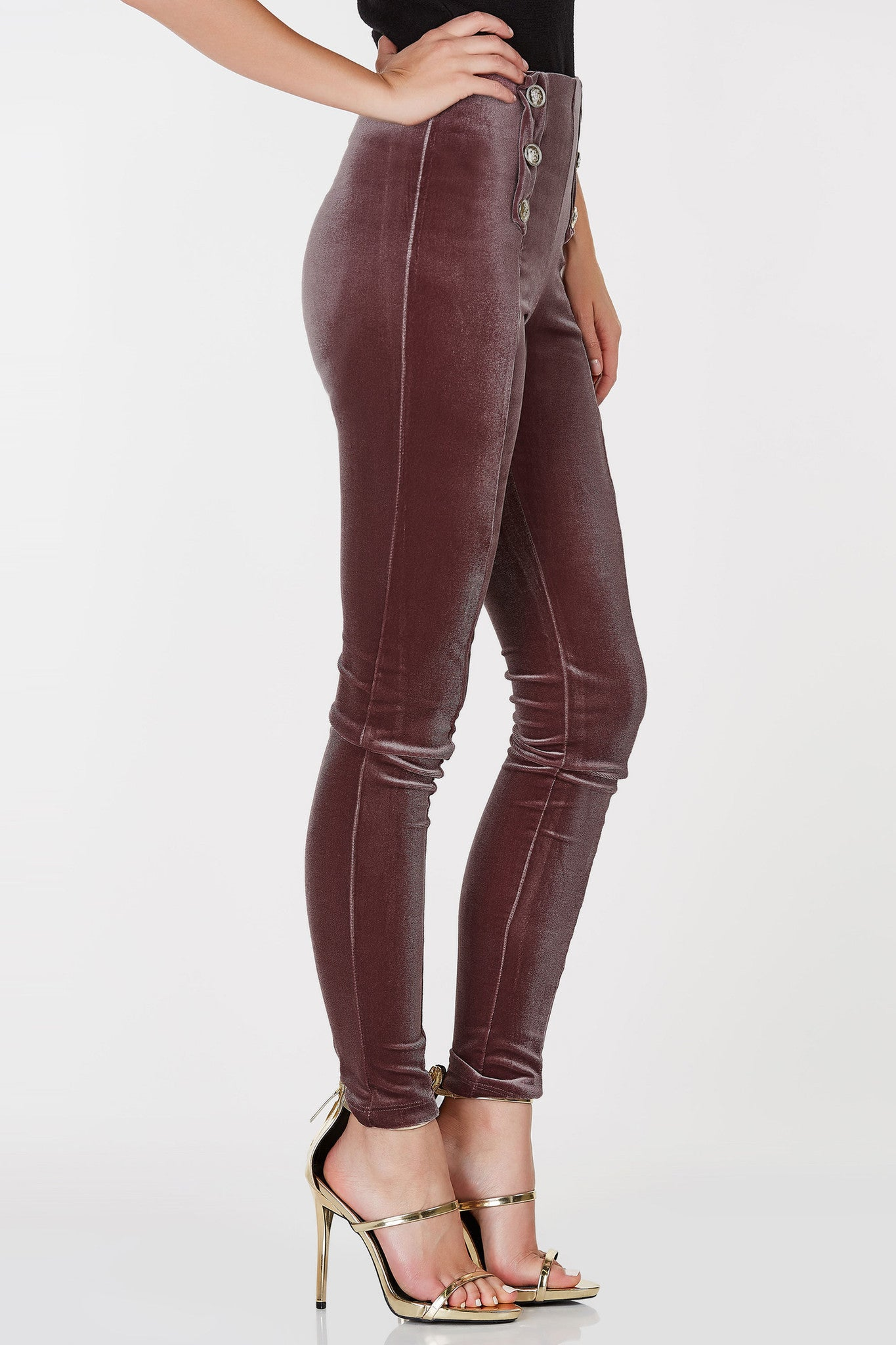 High waisted velvet leggings with emblem button detailing in front.