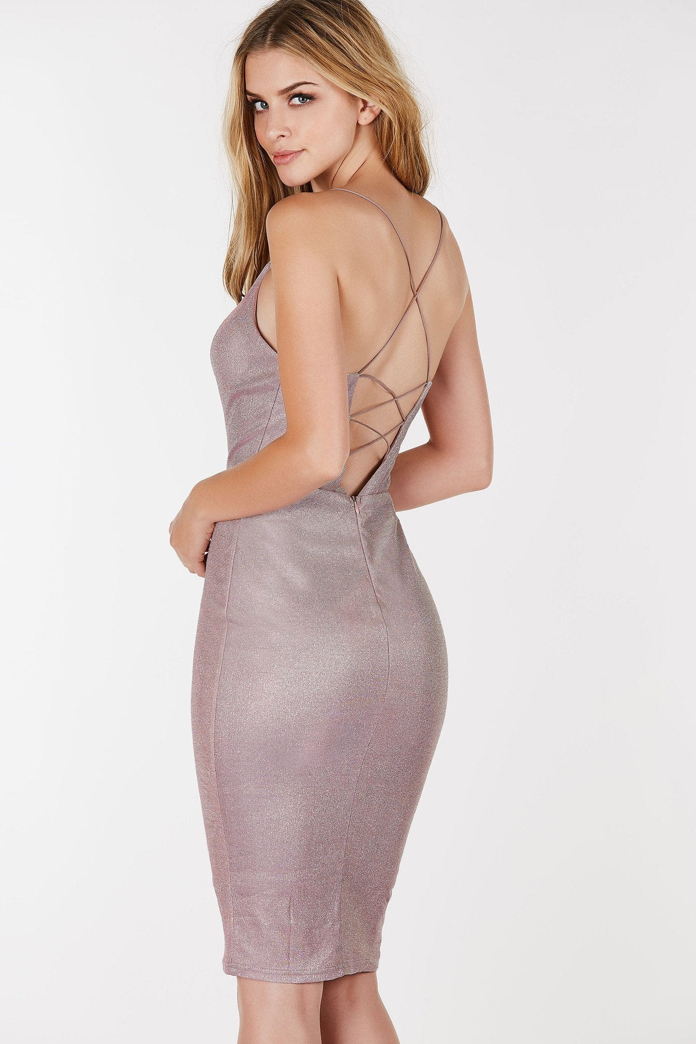 Slim fit midi dress with a deep neckline and plunging back. Strappy detailing with glitter finish.