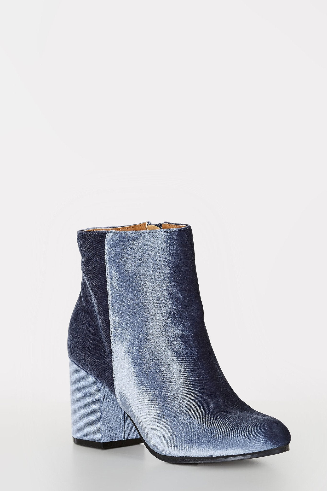 Velvet ankle boots with soft rounded toe. Side zip closure with chunky block heels.