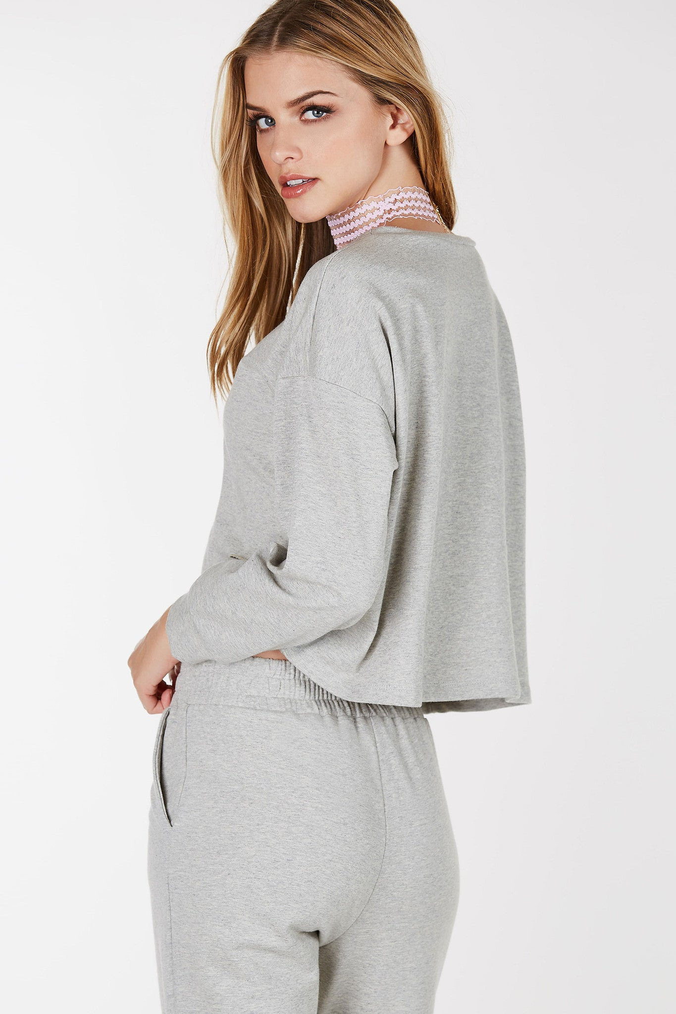 Crew neck long sleeve sweatshirt with distressing. Cropped straight hem with oversized fit.