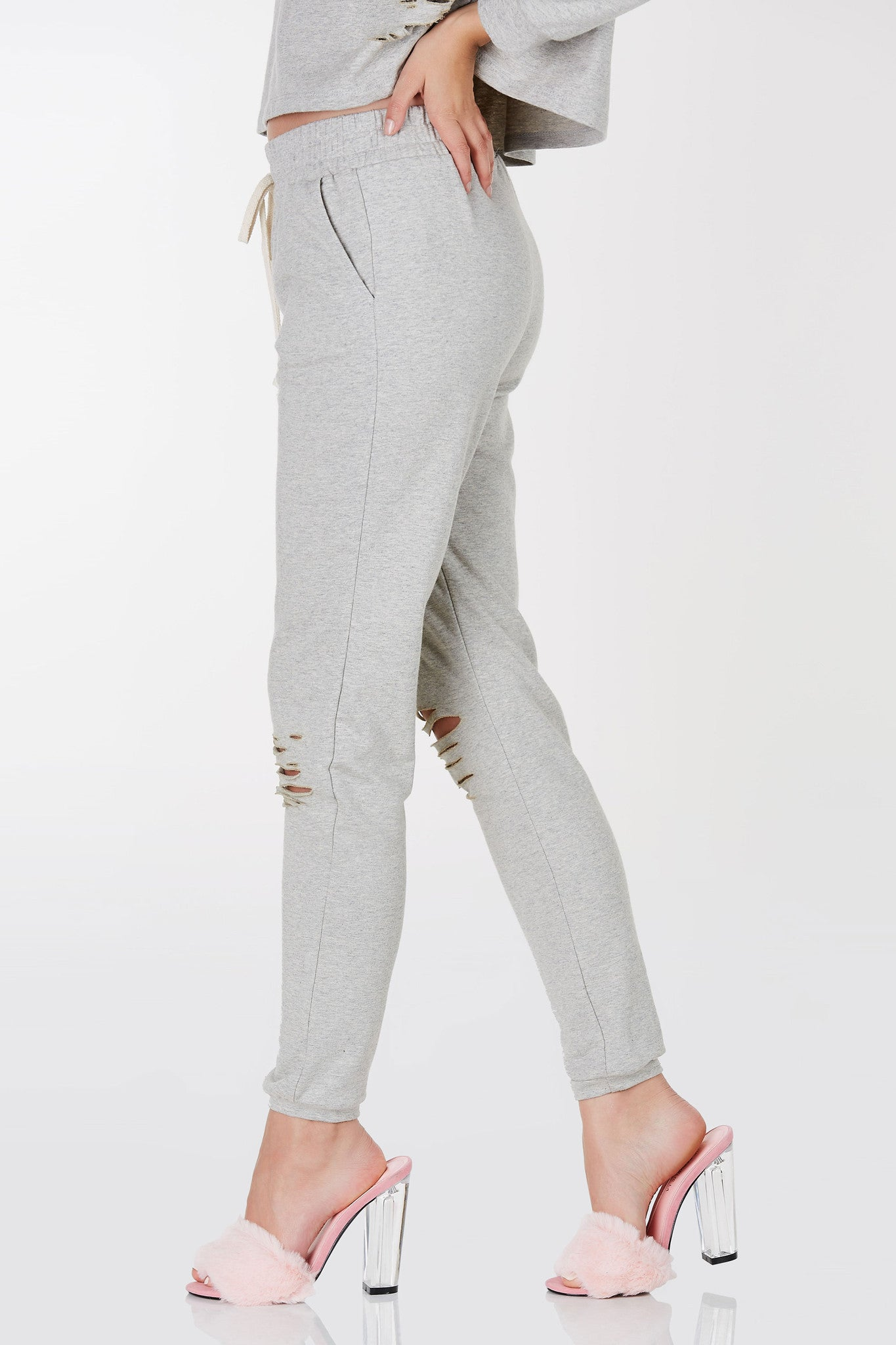 Classic drawstring sweatpants with relaxed fit. Elasticized waistband and distressing in front.