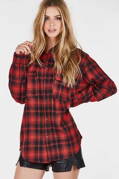 Longling flannel button down with classic plaid print throughout. Classic collar with rounded hem.