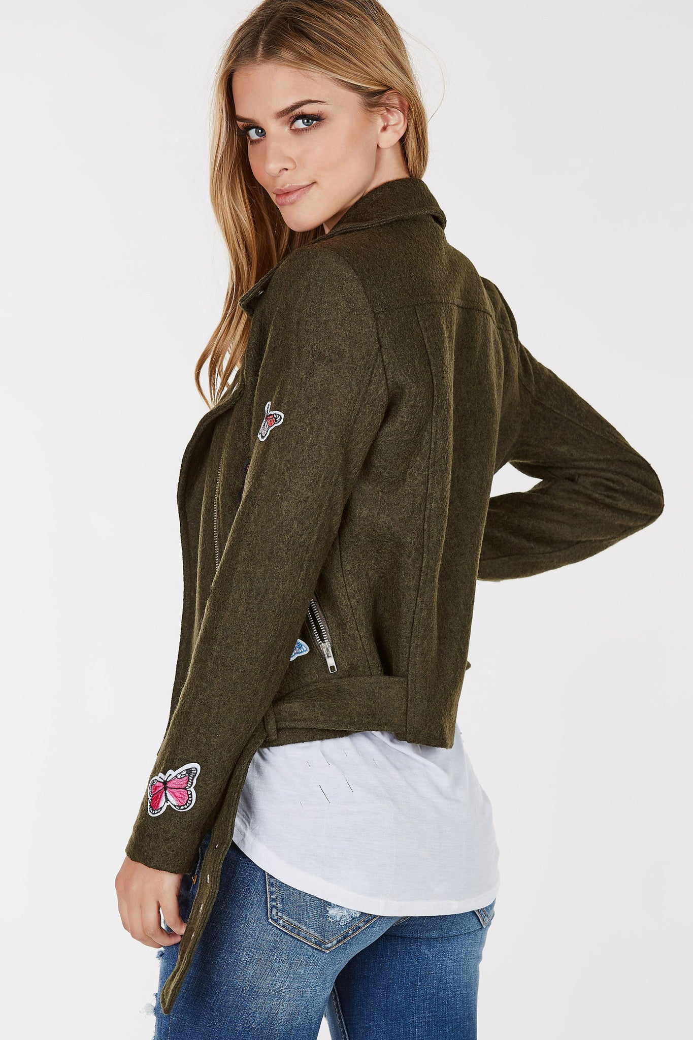 Wool blend moto jacket with butterfly patches throughout the front. Assymetrical front zip closure.
