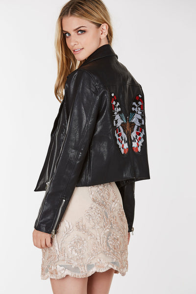 Nasty gal faux leather moto jacket with intricate butterfly patch in back. Relaxed fit with asymmetrical front zip closure.