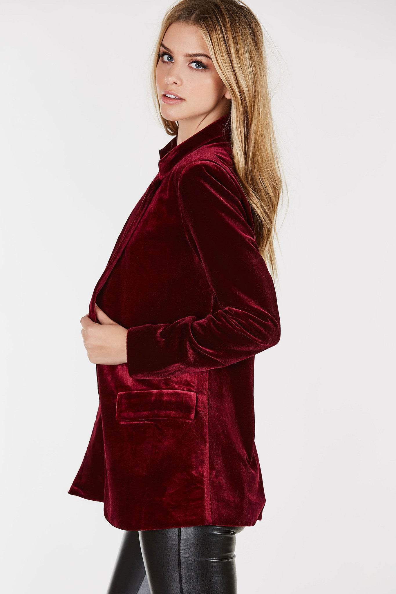 Relaxed fit boyfriend blazer with luxe velvet finish. Classic lapels with single button closure.