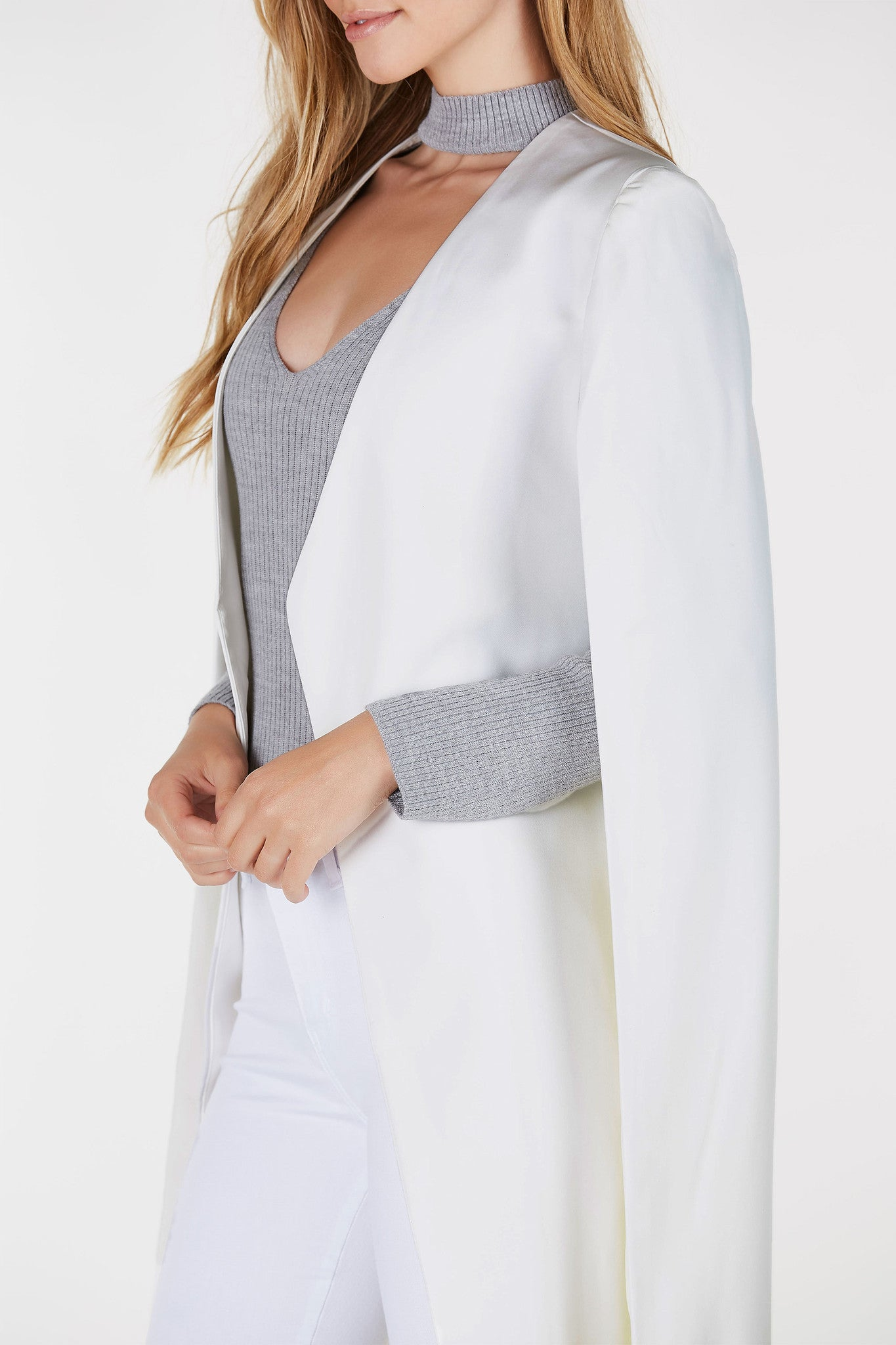 Open front blazer with cape design. Longline hem with full lining.