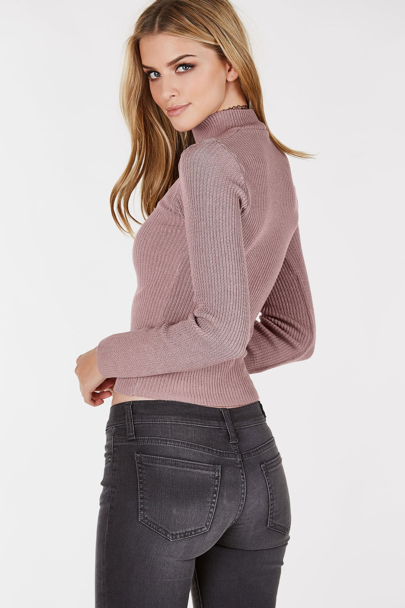 Ribbed long sleeve top with choker neckline and cut out in front. Slim fit with straight hem all around.