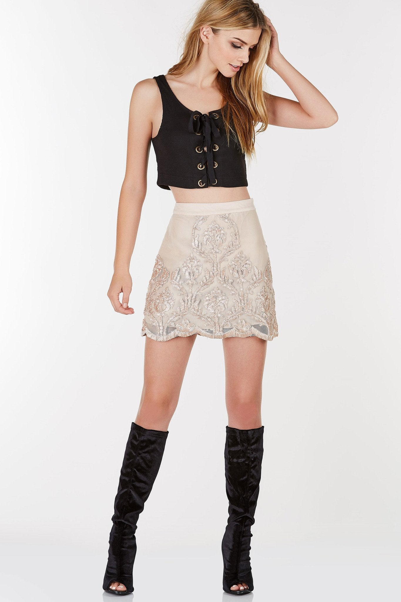 Ribbed sleeveless crop top with lace up design. Eyelet detailing with straight hem alla round.
