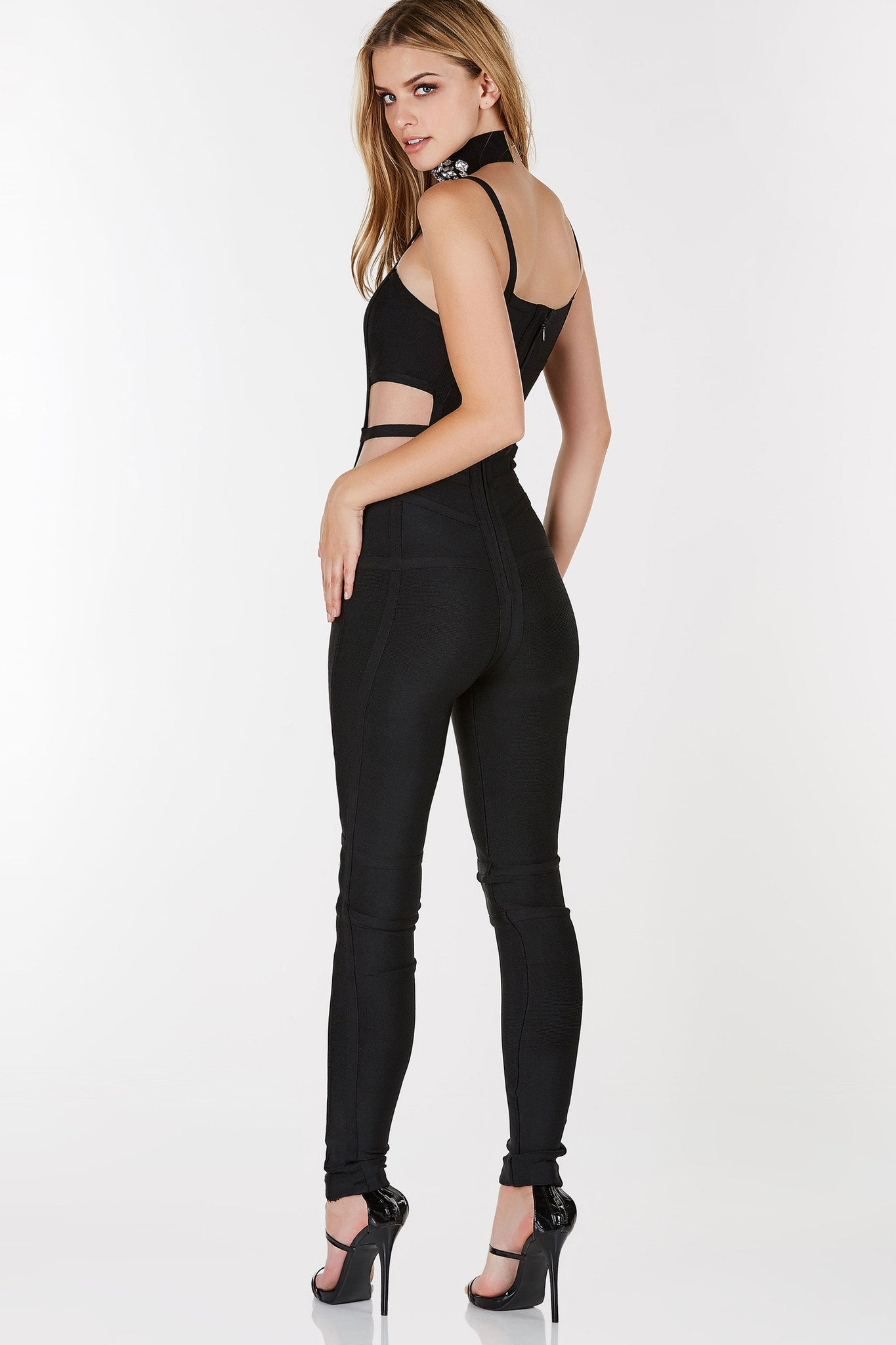 Bandage style jumpsuit with cut outs on each side. Slim fit with comfortable stretch and back zip closure.