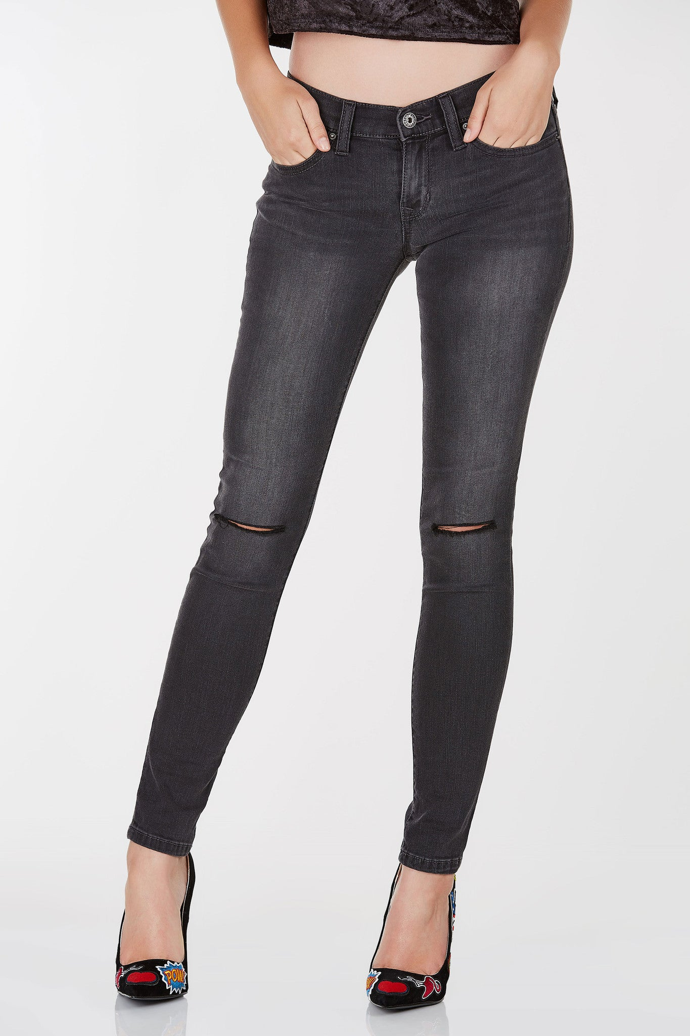 Low rise skinny jeans with slight faded wash.Knee slits with straight hem all around.