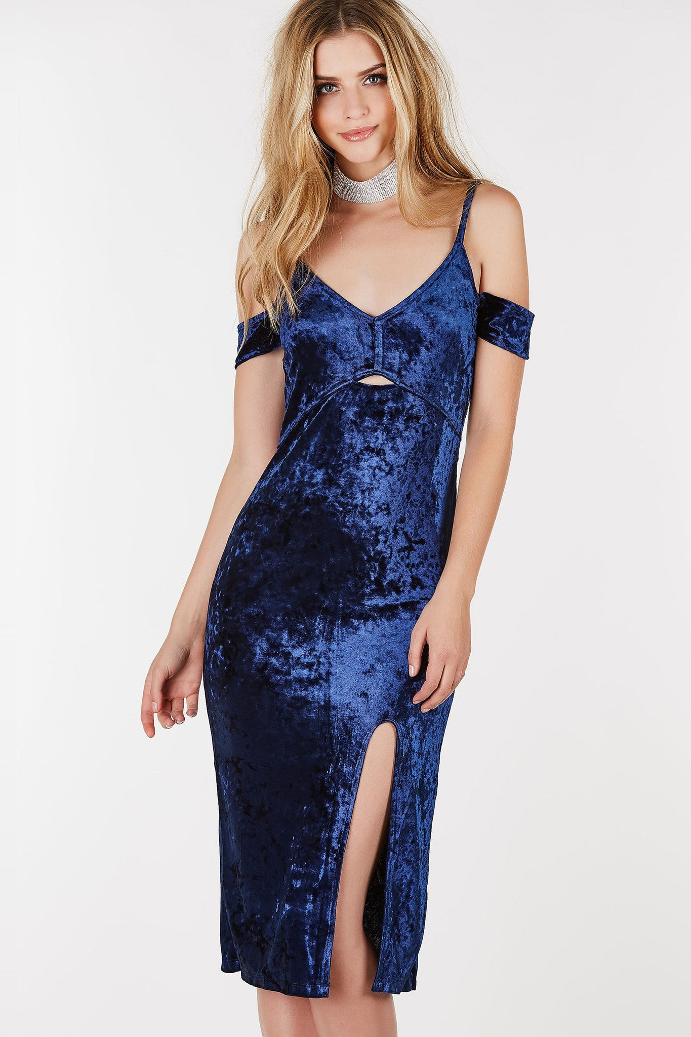 V-neck midi dress with cold shoulder cut outs. Velvet finish with slit in front.