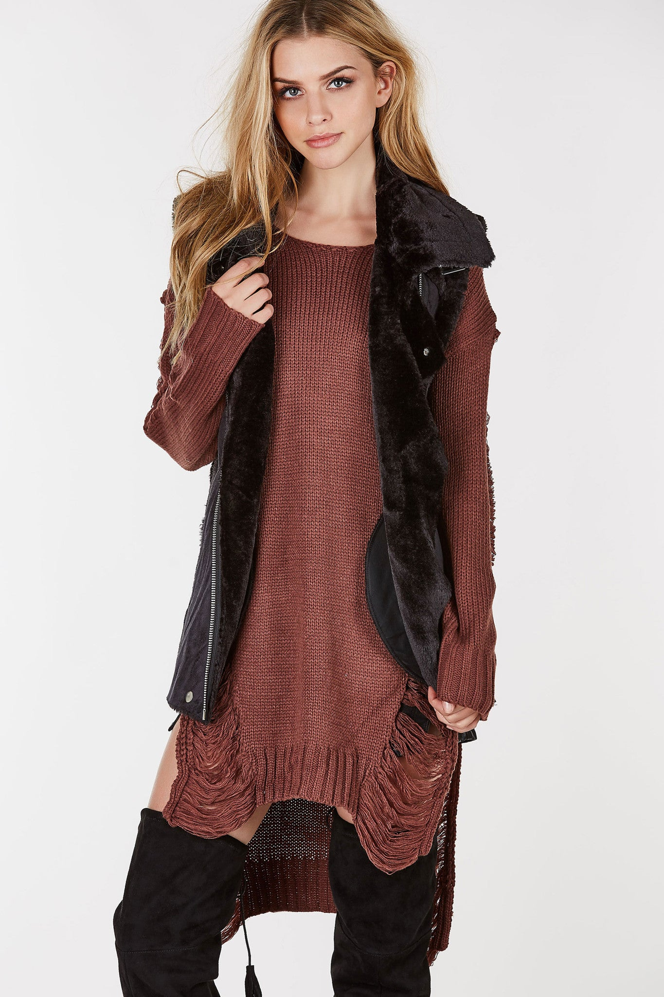 Suede moto vest with fur lining.  Longline fit with zipper pockets in front.