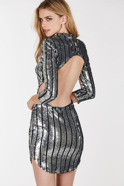Long sleeved, sequin dress with shoulder pads and open back.  Perfect for a night out or New Years party.
