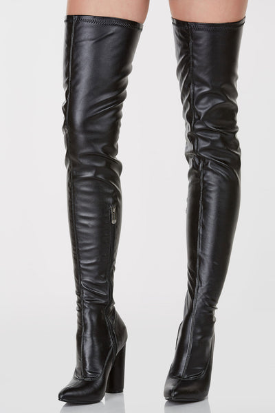 Pointed toe faux leather thigh high boots. Side zip closure with stretchy fit.