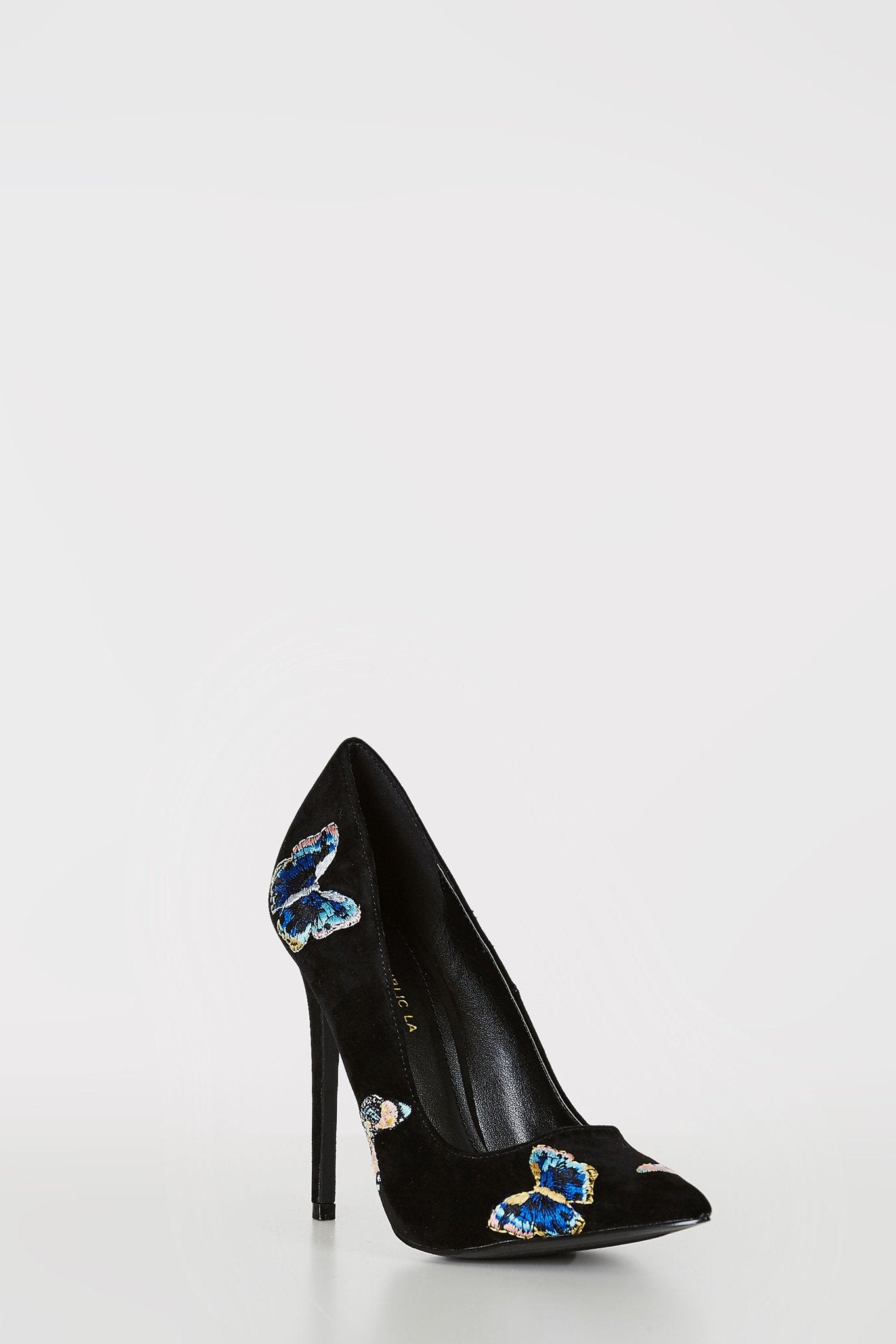 Pointed toe suede pumps with butterfly patches.