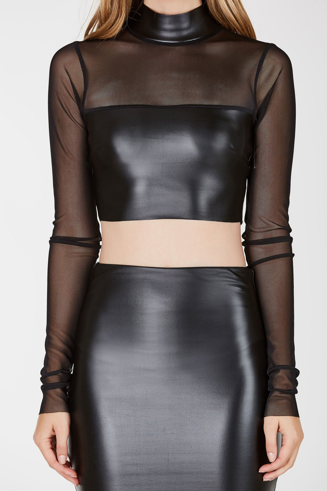Mock neck long sleeve crop top with contrast faux leather panels. Comes in a set with matching skirt sold separately.